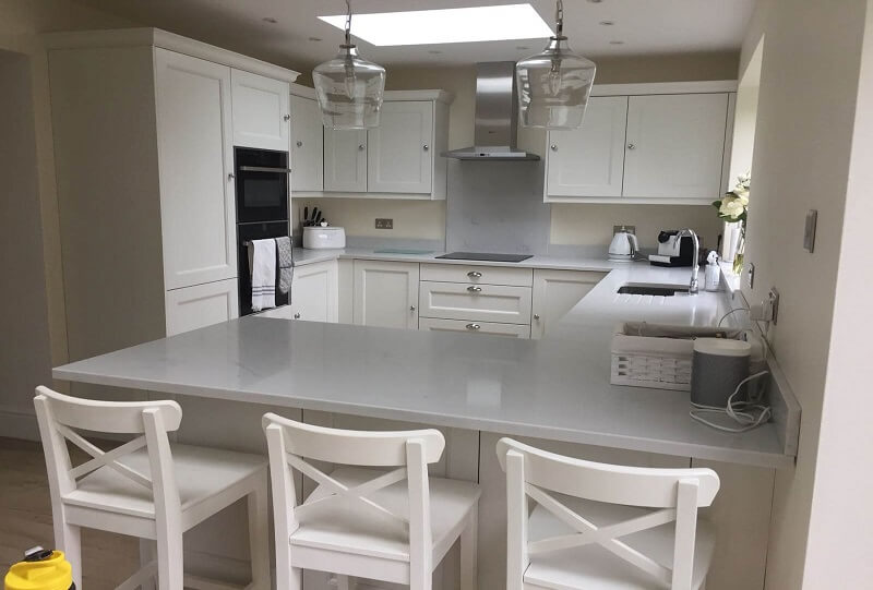 White Kitchen With Granite Worktop